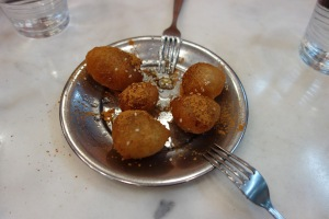 Honey fritters with cinnamon - food tour.